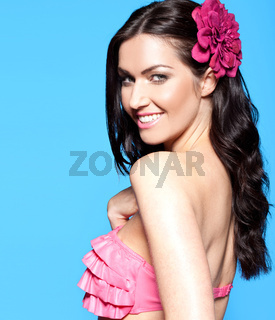 sexy brunette woman with a flower