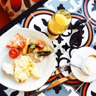 High angle of healthy delicious breakfast in cafe on table