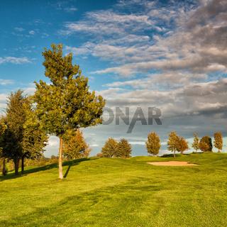 Summer golf course at sunset