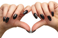 Female hands with black nails manicure isolated on white background.