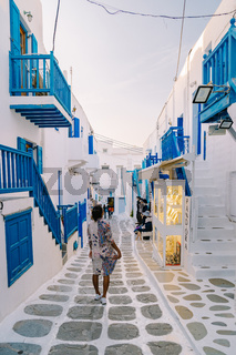 Mykonos Greece , colorful streets of the old town of Mykonos with tourist in the street