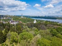 Botanical garden, statue, churches and cloudy sky
