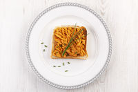 Roasted red pepper spread - muhammara on toast with chive.
