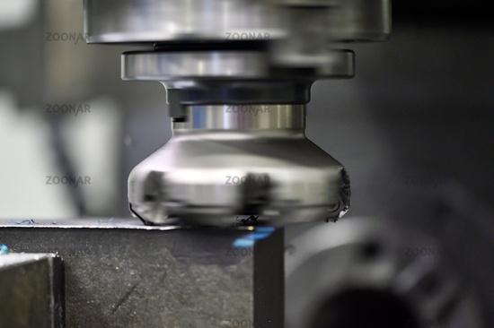 Metalworking. Universal vertical milling machine mills metal.
