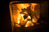 wood is burning in the stove. Fire burning firewood.
