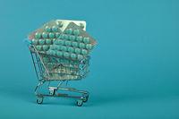 Several blister packs of pills in shopping cart