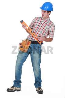 Construction worker playing air guitar