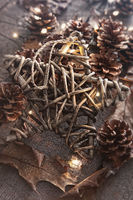 Wooden star with pine cones and leaves