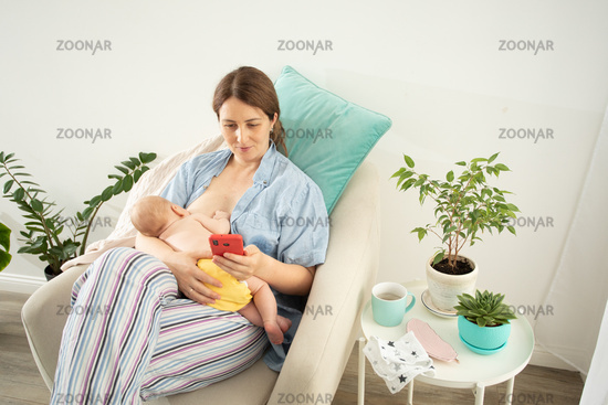 Comfortable and tranquil breastfeeding in cosy armchair at home