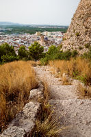 Stairs along the castle 'Santa Anna' with aerial view on the Spanish old town Oliva, Spain