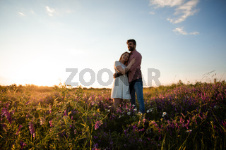 Happy couple embracing outdoors in the meadow