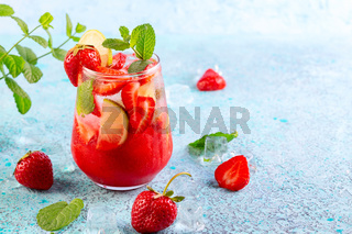 Ice-cold strawberry drink with lime.
