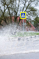 spray of a passing car in a puddle