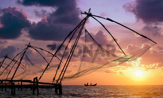 Sunset over Chinese Fishing nets and boat in Cochin (Kochi)