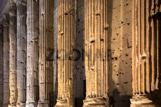 Detail of illuminated column architecture of Pantheon by night, Rome - Italy