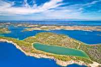 Telascica nature park cliffs and green Mir lake on Dugi Otok island aerial view