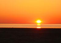 Sunrise Panorama view to Aral sea from the rim of Plateau Ustyurt near Aktumsuk cape in Karakalpakstan, Uzbekistan