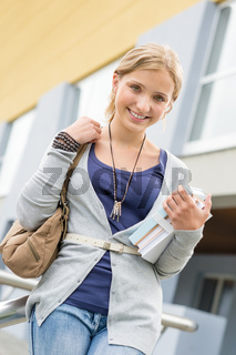 Student girl holding her books to school
