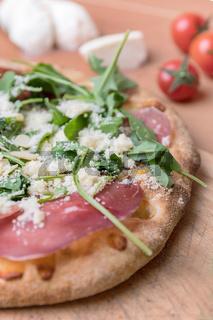Pizza with raw ham