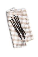 Vanilla pods on checkered napkin. Sticks of vanilla