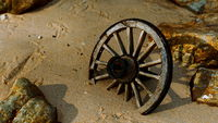 Old wooden cart wheel at sand beach