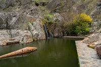 Penha Garcia historic village waterfall and Pego river beach on a cloudy day, in Portugal