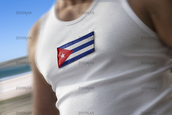 The national flag of Cuba on the athlete's chest