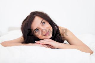 Peaceful brunette woman lying on her blanket
