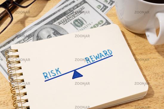 Risk reward concept. Drawing on notepad on desk
