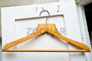 clothes hanger on old white door
