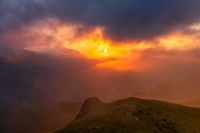 Mountain dramatic sunset in clouds