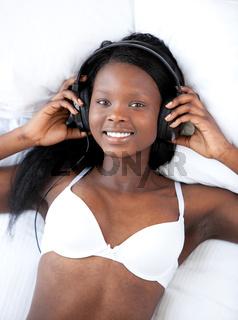 Bright woman in underwear listening music