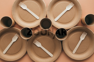 Eco-friendly kraft paper fork, cup and plate. Zero waste and recycling concept.