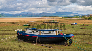 Boats in the grass, seen in Askam-in-Furness, Cumbria, England