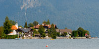 The village Walchensee on the lake Walchensee with mountains in background