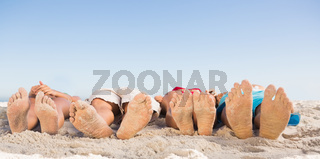 Feet of friends lying together