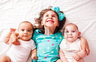 the little girl and babies have a happy childhood
