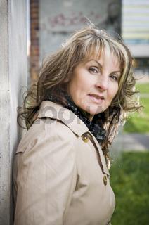 Woman lean against the wall