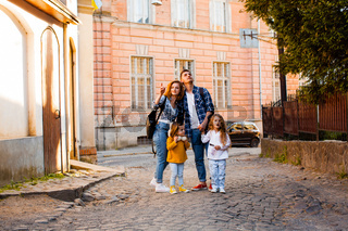 The family are walking around the old town at the summer