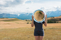 Woman in blue dress in summer Altai mountains