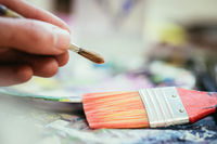 Painting artwork: paint brushes on painting background
