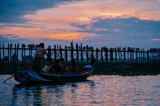 Silhouetted person on U Bein Bridge at sunset, Amarapura, Mandalay region, Myanmar