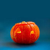 Halloween pumpkin on blue
