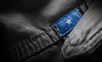 Tag on dark clothing in the form of the flag of the Somalia