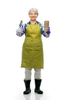 old woman in apron with pruner and flower pots