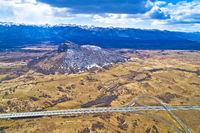 Lika region. Zir hill and Velebit mountain in Lika landscape view. A1 highway