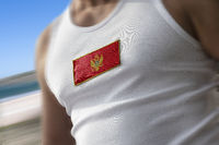 The national flag of Montenegro on the athlete's chest