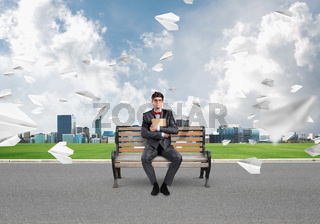 young businessman with a book