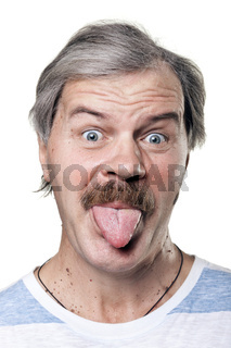 funny mature man shows tongue isolated on white background