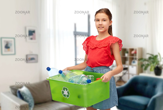 smiling girl sorting plastic waste at home